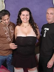 Giant tits Denise Davies sucking and spitroasted by two cock