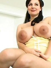 Luscious Lorna slide her top to show her huge tits