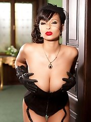 Busty Dominno drops corset and show her sweet pussy