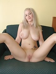Sweet blonde angel with big boobs getting nude and exposing her pink pussy