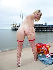 Crazy young bitch poses nude and in sexy stocking at the harbour and exposes her big hooters